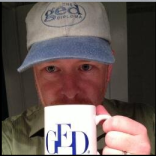 Jason Guard with his GED mug