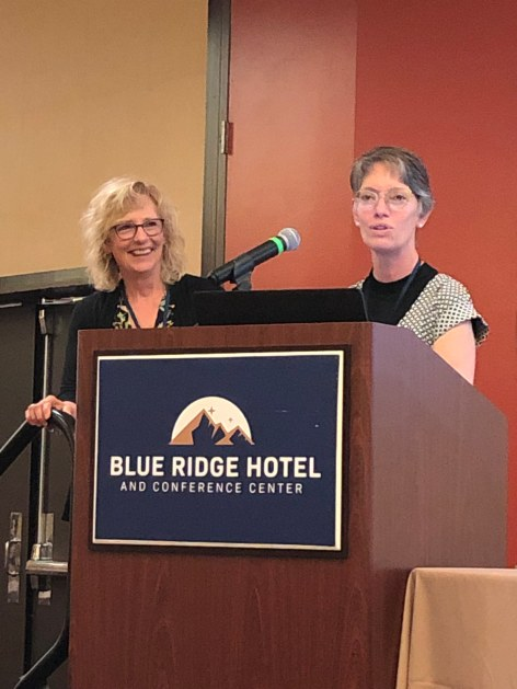 Lynne Wheeler receiving the Nancy Jiranek Award for Outstanding Director from Heidi Silver-Pacuilla at the AE&L Conference in Roanoke.